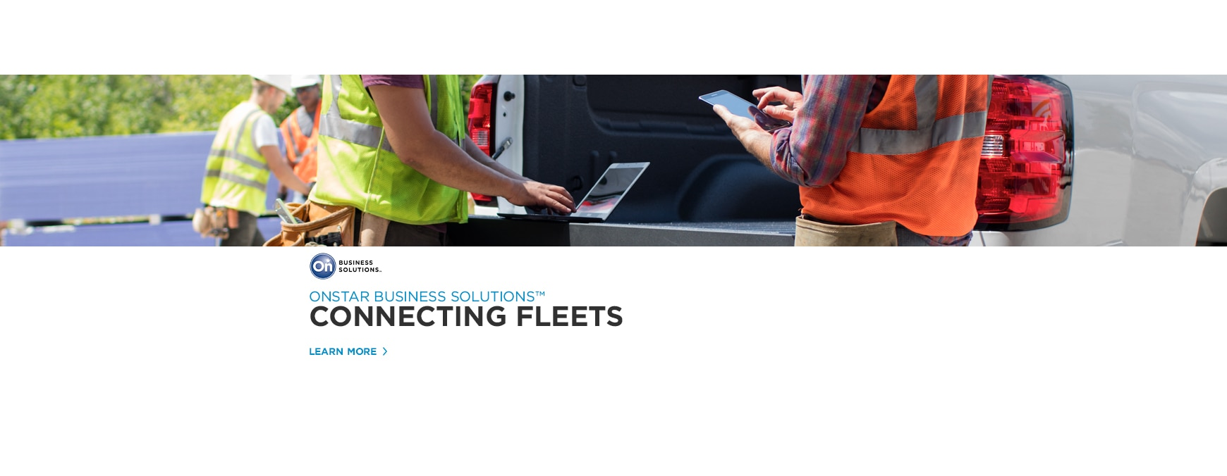 Chevrolet Silverado Work truck with construction workers checking phones at tailgate.  ONSTAR BUSINESS SOLUTIONS™: CONNECTING FLEETS.  LEARN MORE.