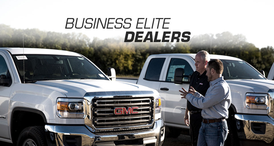 View of a business elite dealer discussion in front of GM Fleet vehicles.